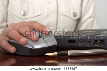 Mouse, hand and laptop connections - stock photo