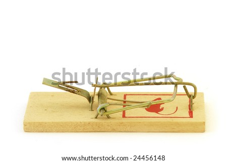 Mouse trap waiting for its victim.  Isolated on white. - stock photo