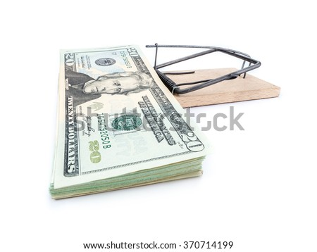 Mouse trap with 20 dollar bill pile attached as bait on whiite background - stock photo