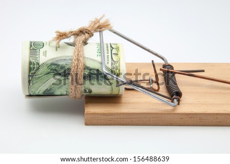 mousetrap with a bundle of tickets for hundred dollars - stock photo