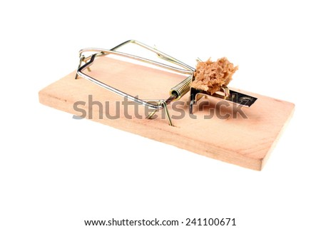 Mousetrap with a piece of bread on a white background - stock photo