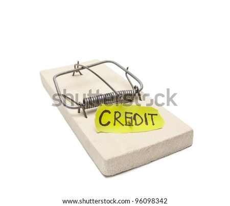 Mousetrap with bait credit inside. Debtor's prison concept image. Object on white, focus on inscription - stock photo