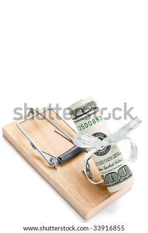 Mousetrap with hundred dollars bill is isolated against a white background - stock photo