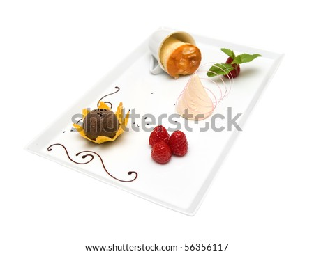 """Mousse """"Champagne"""" with a soufflé of cottage cheese and almonds ice cream with black sesame - stock photo"""
