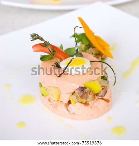 Mousse tomato with salad Nicoise - stock photo