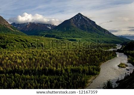 Moutains and Matanuska river along Alaskan highway 1 - stock photo