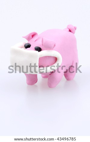Mouth covered clay pig swine flu concept - stock photo
