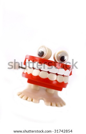 Mouth full of teeth windup toy - stock photo