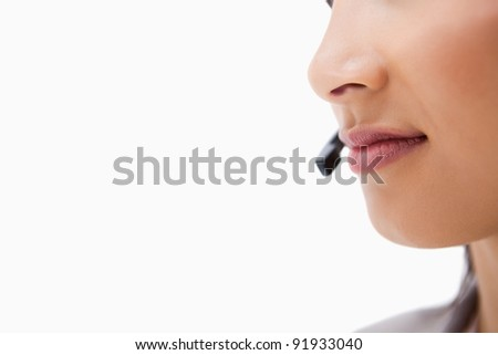 Mouth of female call center agent against a white background