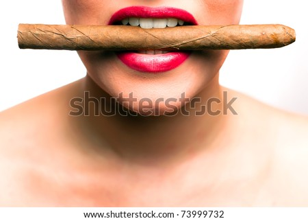 mouth with red lips with a cigar between the teeth