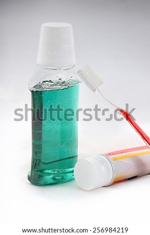Mouthwash, toothbrush and toothpaste buccal health background. - stock photo