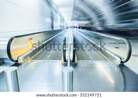 Movable conveyor belts at the airport, motion effect. - stock photo