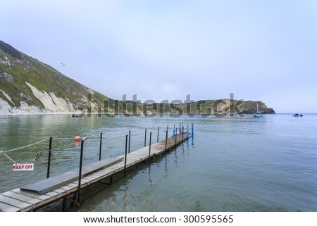 Movable pontoon on the seashore in Lulworth Cove on the Jurassic Coast, West Lulworth, Dorset, south-west England, UK - stock photo