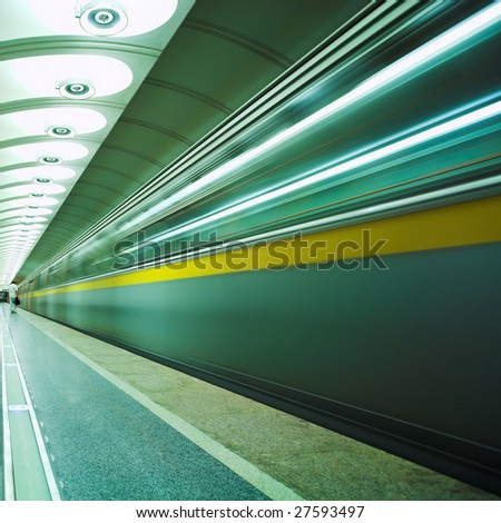 Move train in green on platform in subway - stock photo