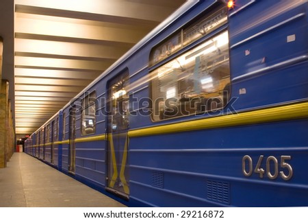 Move train in subway, on platform - stock photo