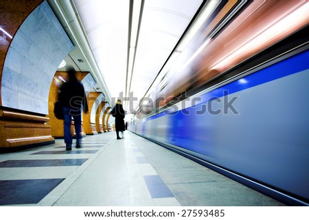 Move train on underground station platform - stock photo