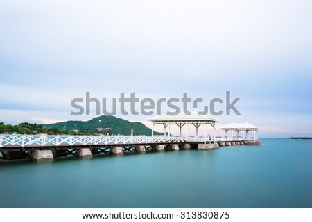 Movement during this long exposure. Bridge column in the sea with Sichang island.