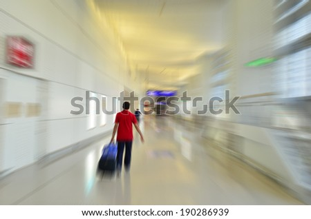 Movement of a traveller in the airport - stock photo