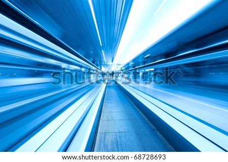 movement of abstract blue escalator with people - stock photo