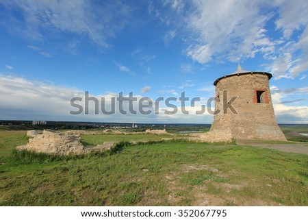 Movement of clouds over the Tower of ancient Bulgar fortress on a high cliff on the banks of the Kama River, Elabuga, Republic of Tatarstan, Russia - stock photo