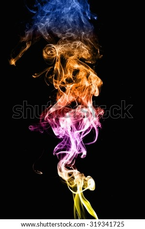 movement of color smoke, Abstract colorful smoke on black background, smoke background,colorful ink background,Yellow adn Violet and Orange and Blue smoke,beautiful color smoke - stock photo