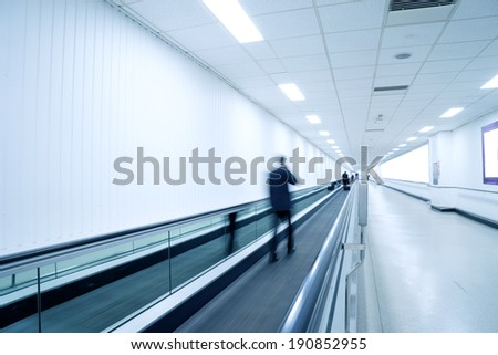 Movement of escalator with business people at the airport.  - stock photo