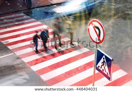 movement of people and cars on the pedestrian crossing the intersection, blurred motion