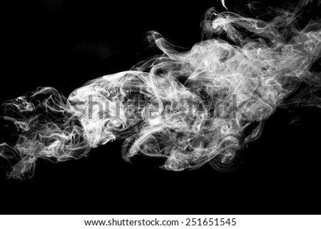 movement of smoke on black background. - stock photo