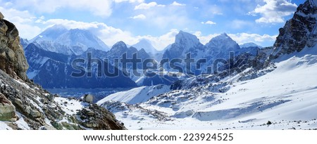 Movement of the clouds on the mountains Everest, Renjo Pass. Himalayas, Nepal. - stock photo