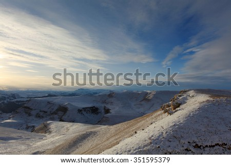 Movement of the clouds on the mountains, Northern Caucasus, Russia. - stock photo