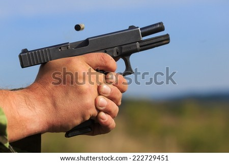 movement of the gun when fired - stock photo