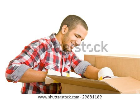 Mover helping to pack packing cases - stock photo