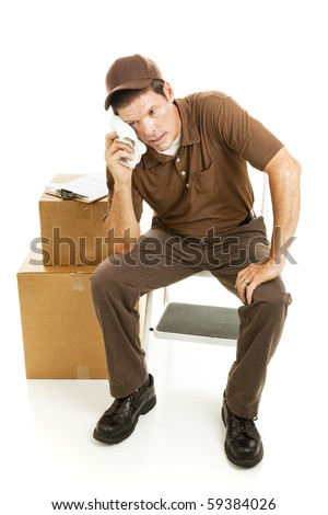 Mover or delivery man sits down to rest on a busy day.  Full body on white background. - stock photo
