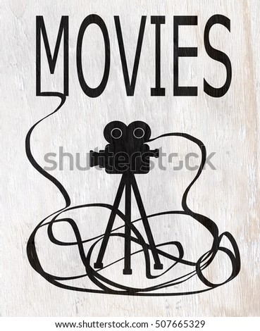 movie and film projector on wood grain texture
