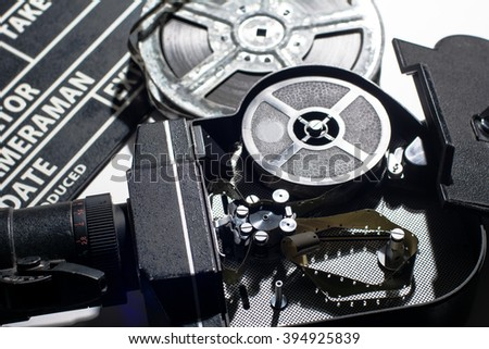 Movie Camera with the lid open. Reel with film and cinema clap.  - stock photo