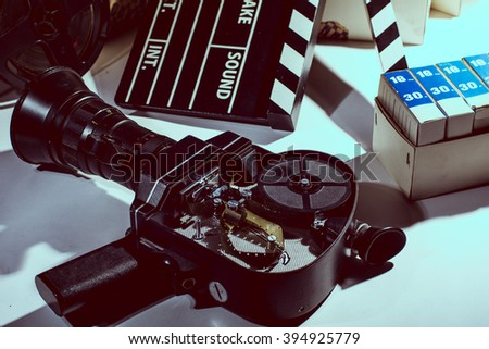Movie Camera with the lid open. Reel with film and cinema clap. Cinema film boxes. - stock photo