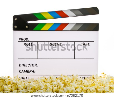 Movie Clapper Board in popcorn isolated on white - stock photo