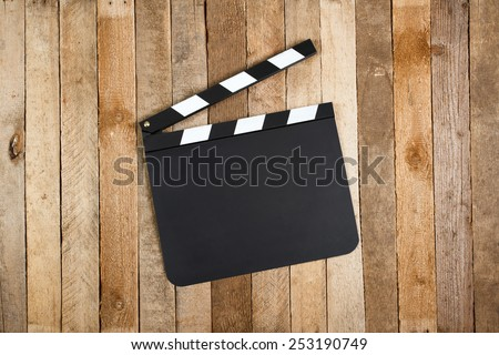 Movie clapper board on a vintage wooden background - stock photo