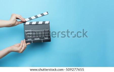 movie clapper on blue background, cinema concept