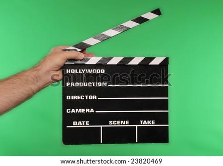 movie clapper on chroma green - stock photo