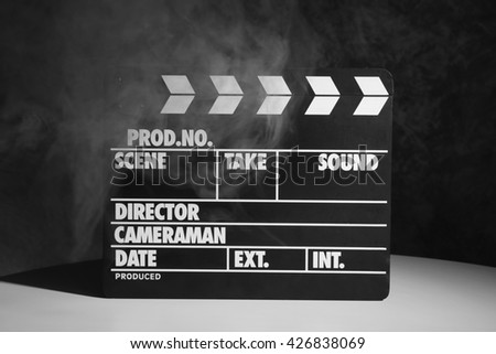 Movie clapper on dark background - stock photo