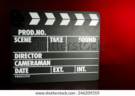 Movie clapper on dark color background - stock photo