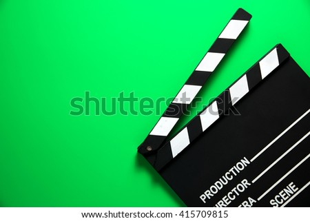 Movie clapper on green background - stock photo