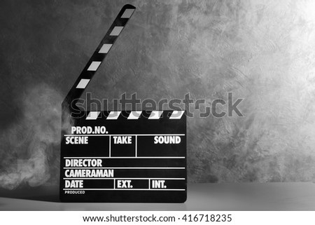 Movie clapper on grey background - stock photo