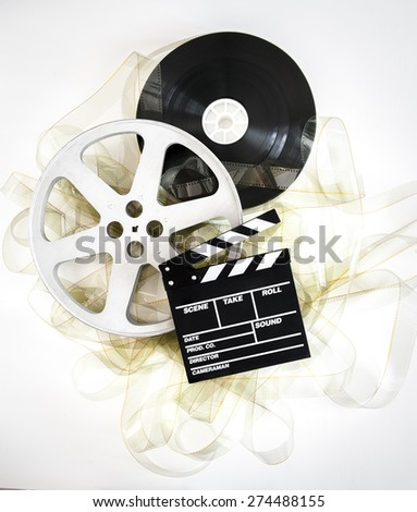 Movie clapper on 35 mm cinema reels unrolled filmstrip on neutral background - stock photo