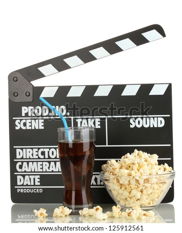Movie clapperboard, cola and popcorn isolated on white