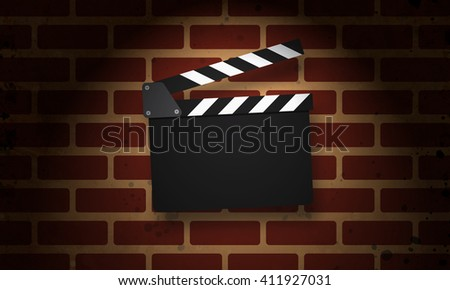 Movie clapperboard on a grunge brick wall - stock photo