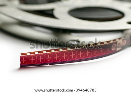 Movie Film on reels; 16mm movie film on spools/reels; differential focus; good extendable copy space  - stock photo