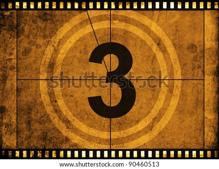 movie film strip with countdown number on grunge background