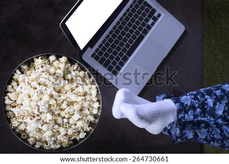 Movie online with popcorn - stock photo
